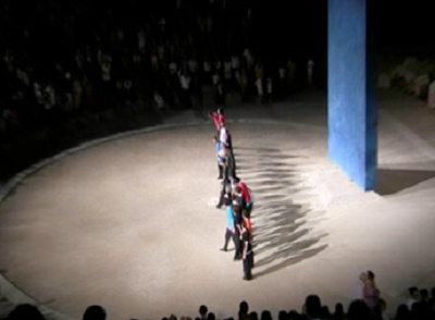 The cast of The Persians with the blue wall in the background, the only stage prop used. http://camerastyloonline.wordpress.com
