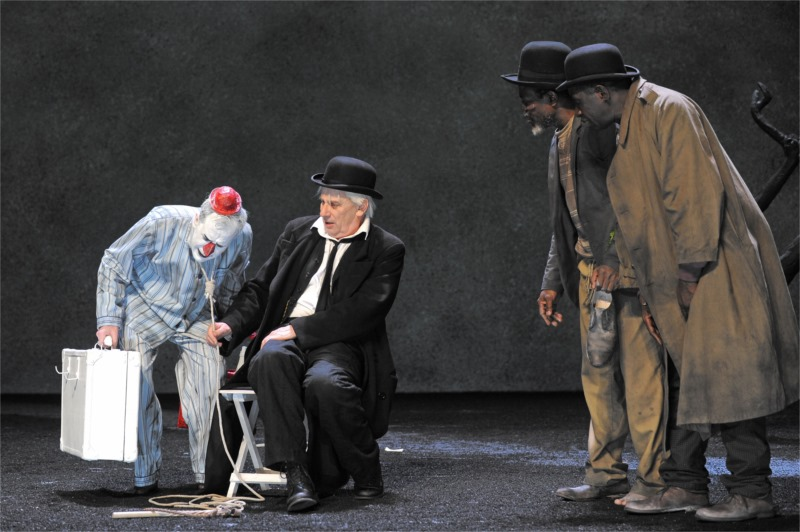 "Lucky (Jean Lambert-wild, left) with his host Pozzo (Marcel Bozonnet) meet Estragon (Fargas Assandé) and Vladimir (Michel Bohiri, right) in ""Waiting for Godot."" Photo by Tristan Jeanne-Valès"