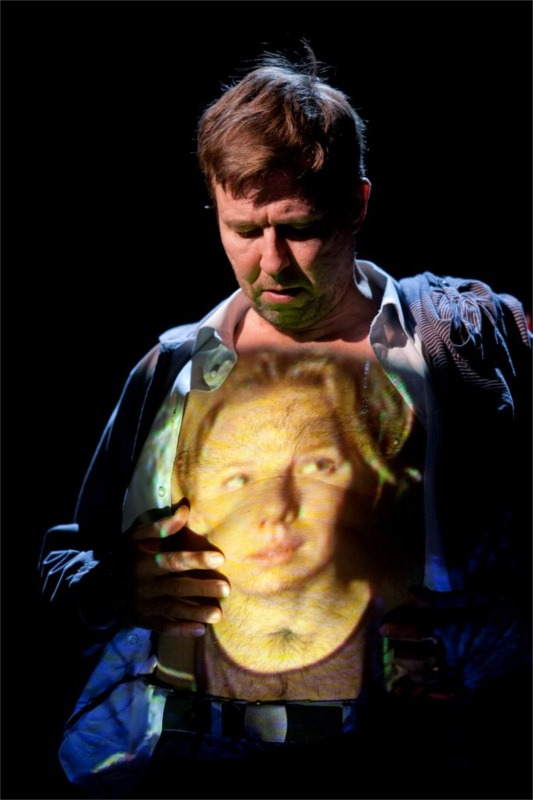 Marked by love: the guard (Martti Suosalo) feels the presence of the speleologist (Alma Pöysti) on his heart. Photo by Stefan Bremer