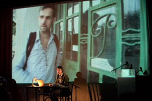 Performer interacting with a video projection of Schlingensief in Via Intolleranza II, Theatertreffen 2011, Berlin, May 2011 © David Baltzer