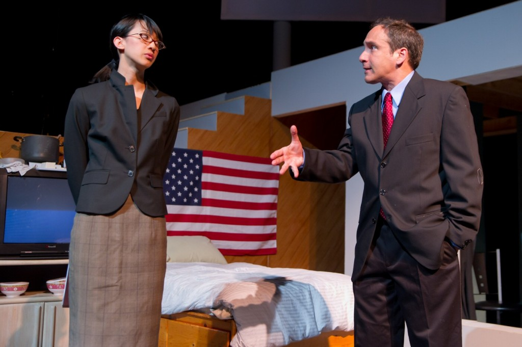 Jennifer Vo (Assistant) and Garth Petal (President) in Beijing, California, by Paul Heller, dir. Duy Nguyen.Thick House Theater, San Francisco, CA, prod. Asian American Theater Company, San Francisco. Photo Guy Stilson