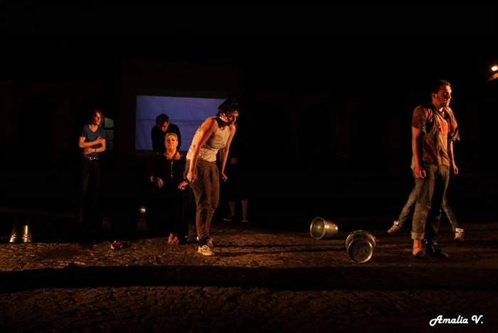 "Scenes from the award-winning performance of Teatime Europe at Man.In.Fest, Cluj-Napoca, Romania, July 2015. Water in the tin buckets became the essential performative liquid element. Performers are in the end asked to towel-dry the wet ""foreign"" bodies. A video projection of the Evros River is placed at the background, behind the singer Kaiti Makri."