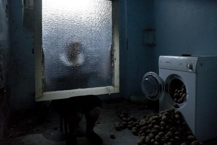 A scene during the 2015 interactive performance installation in the former cells of Mülheim's women's prison. Photograph by Franziska Götzen