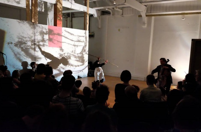 Fig. 1 Macarena Ortuzar dancing Stuck with the Bones, with cellist Bruno Guastalla [right] at Really Actually Windy/ R.A.W. Vol 1., I'Klectik Art-Lab, Old Paradise Yard, London. May 7, 2016.
