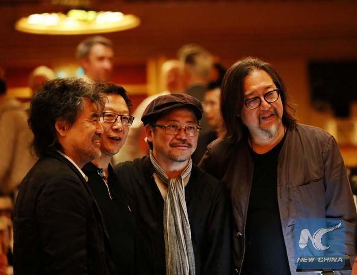 (L to R) David Henry Hwang, Bright Sheng, Tim Yip, and Stan Lai during intermission. Photo: Dong Xudong, Xinhua