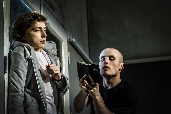 Venyamin (Nikita Kukushkin, right) reads from the Bible to his schoolmate and disciple (Alexandr Gorčilin) in the Gogol Centre production of The Martyr