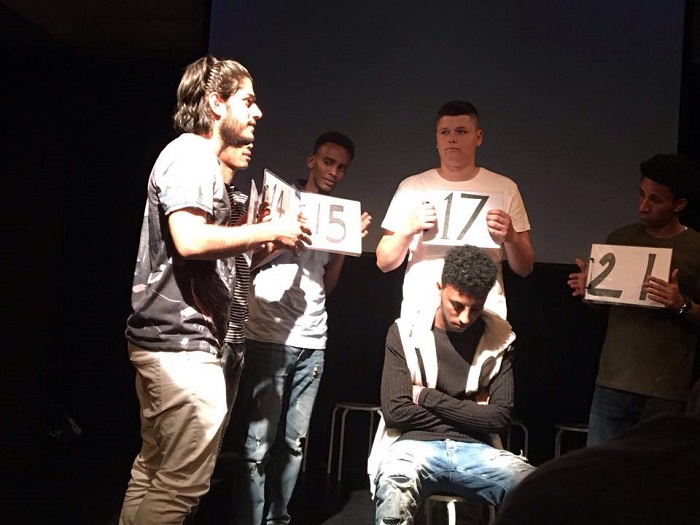 The cast play social workers who estimate Tariq's age. Photo credit: Phosphoros Theatre