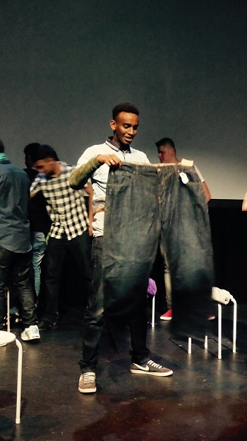 The shopping scene, where Tariq comically chooses inappropriate items of clothing. Photo credit: Phosphoros Theatre
