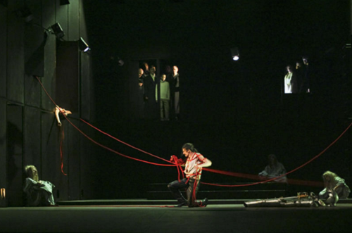 Macbeth, dir. David Zinder, the Tamasi Aron Theatre, Svantu Gheorghe, Romania, March 2006. At center: Tibor Palffy (Macbeth). At left: Gizsela Kicsid (Lady Macbeth, dead). © Zsolt Barabas.