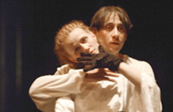 Imola Kezdi as Leah, with Aron Dimeny as Hannan. The Dybbuk at The Hungarian National Theatre of Cluz, Romania, May 13th 2002. Photo by Szabo Robert