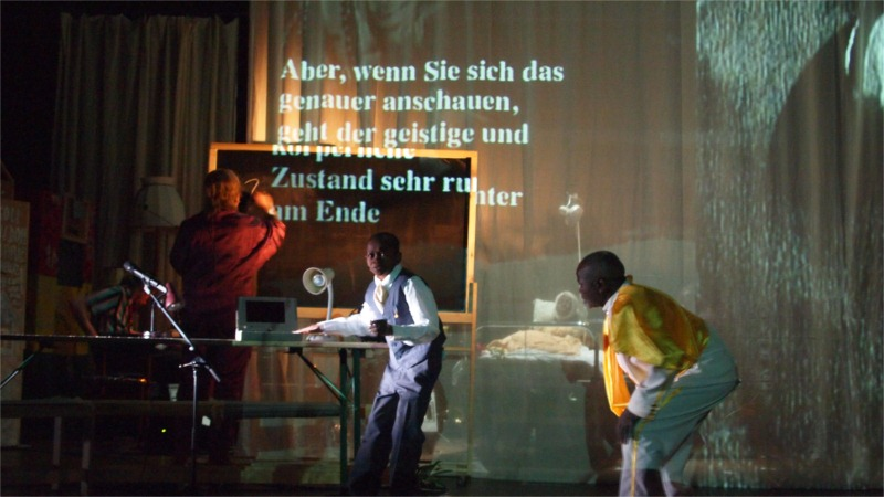 Via Intolleranza II fills the stage with conflicting messages. Photo by Aino Laberenz.