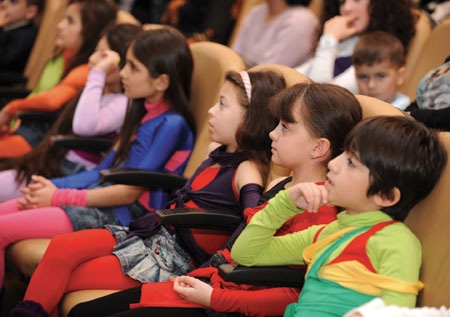 A young audience is captivated …