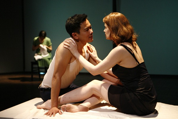 """Sue Jean Kim, Joel de la Fuente and Francis Kelly in """"I Have Been to Hiroshima Mon Amour,"""" written by Chiori Miyagawa, directed by Jean Wagner, co-produced by Voice & Vision and Crossing Jamaica Avenue at Ohio Theater in New York City (USA), 2009 © Photo by Carol Rosegg"""