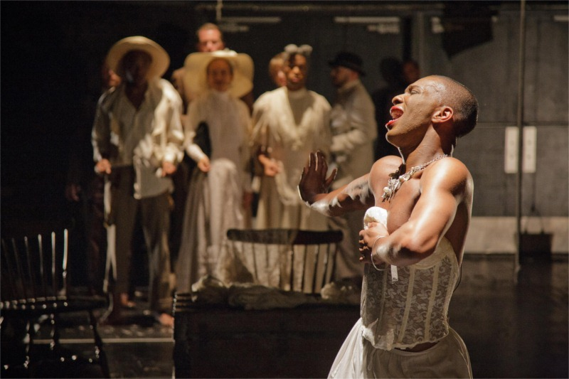 "Dane Figueroa Edidi with ensemble in ""Shape,"" written by Erik Ehn as part of ""Soulographie: Our Genocides,"" a performance cycle, directed by John Moletress, produced by Force/Collision of Washington, D.C. and premiered at La MaMa E.T.C. in New York City (USA), 2009. © Photo by Colin Hovde"