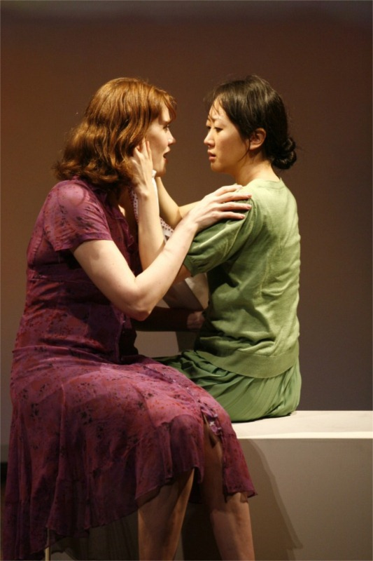 """Sue Jean Kim and Francis Kelly in """"I Have Been to Hiroshima Mon Amour,"""" written by Chiori Miyagawa, directed by Jean Wagner, co-produced by Voice & Vision and Crossing Jamaica Avenue at Ohio Theater in New York City (USA), 2009 © Photo by Carol Rosegg"""