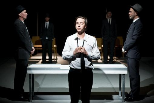 In TAG Theater's The Trial Julian Loidl (white shirt) plays the role of Josef K. © Anna Stöcher