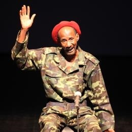 "Adama Bagayoko as Soungalo in ""A Soldier's Story,"" a docu-fiction written by Jean-Louis Sagot-Duvauroux based on ""My Soldier's Life"" by Soungalo Samake; conception by Patrick Le Mauff, Alioune Ifra Ndiaye and Sagot-Duvaroux; direction by Patrick Le Mauff for Compagnie BlonBa (Mali and France) © Patrick Fabre"