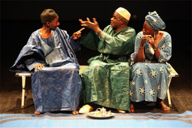"Michel Sangaré, Maïmouna Doumbia and Adama Bagayoko in ""A Soldier's Story,"" a docu-fiction written by Jean-Louis Sagot-Duvauroux based on ""My Soldier's Life"" by Soungalo Samake; conception by Patrick Le Mauff, Alioune Ifra Ndiaye and Sagot-Duvaroux; direction by Patrick Le Mauff for Compagnie BlonBa (Mali and France) © Patrick Fabre"