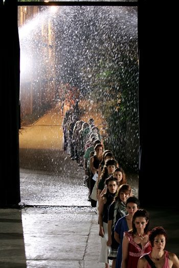 """""""Dying as a Country"""". A performance presented at Athens Festival in 2010, with the participation of two hundred volunteers - we see them entering the theatre. Dir. Michael Marmarinos. © Panos Petropoulos"""