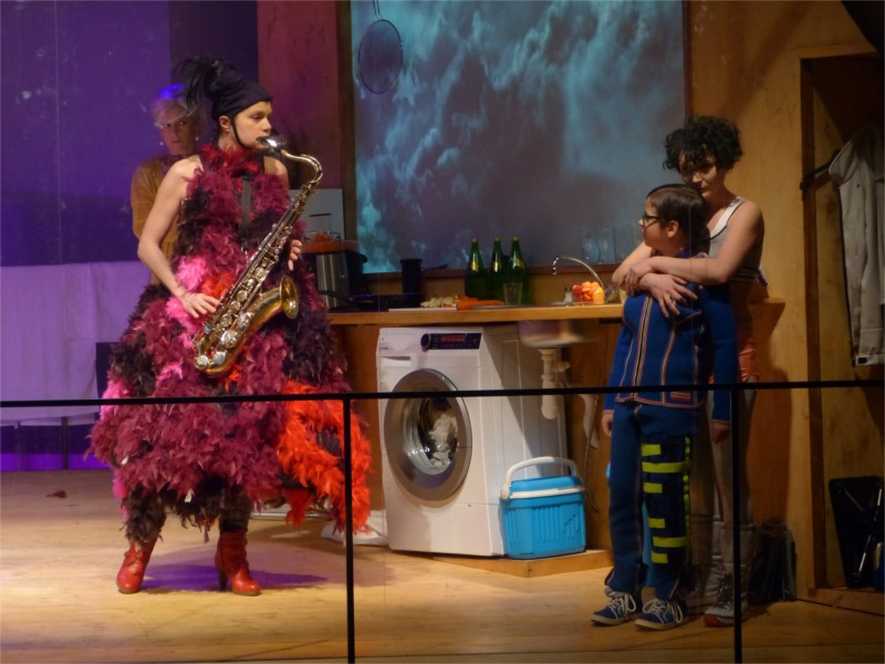 """The Rat Wife serenades """"Little Eyolf"""" in the Allmers' perfect kitchen-diner for Jan Nebesky's Theatre in Dlouha production."""
